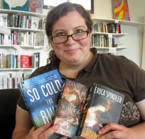 Melissa Eisenmeier, owner of Parkville Bookworm, with three of her favorites.